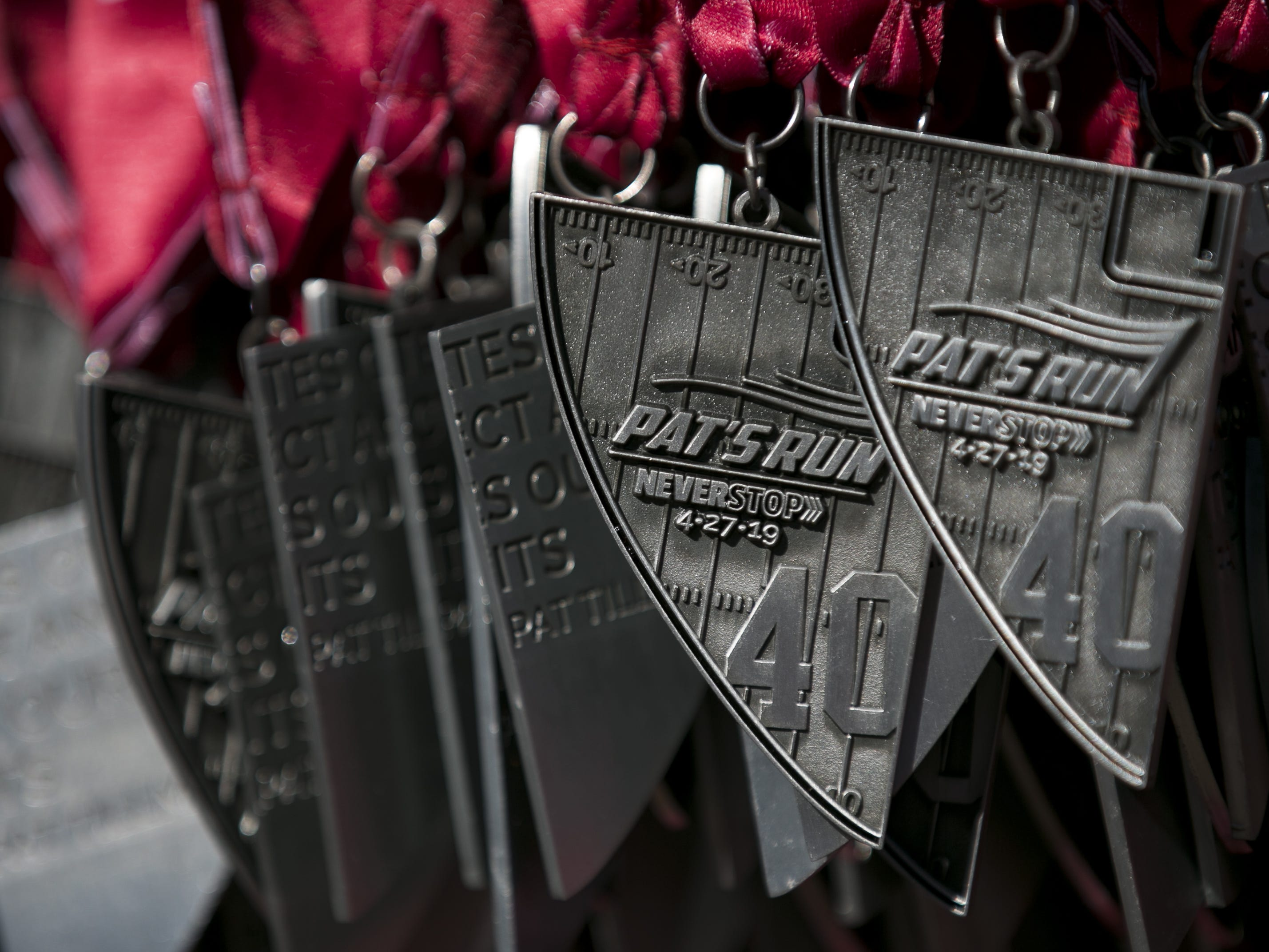Medals for participants hang on a rack at Pat's Run 2019 in Tempe, Ariz. on April 27, 2019.
