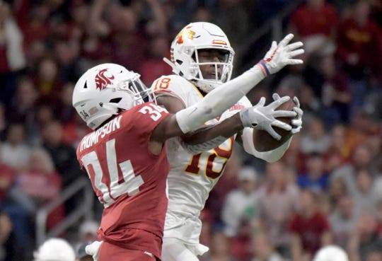Iowa State receiver Hakeem Butler (18) makes a catch in front of Washington State safety Jalen Thompson (34) during the the Alamo Bowl at Alamodome.