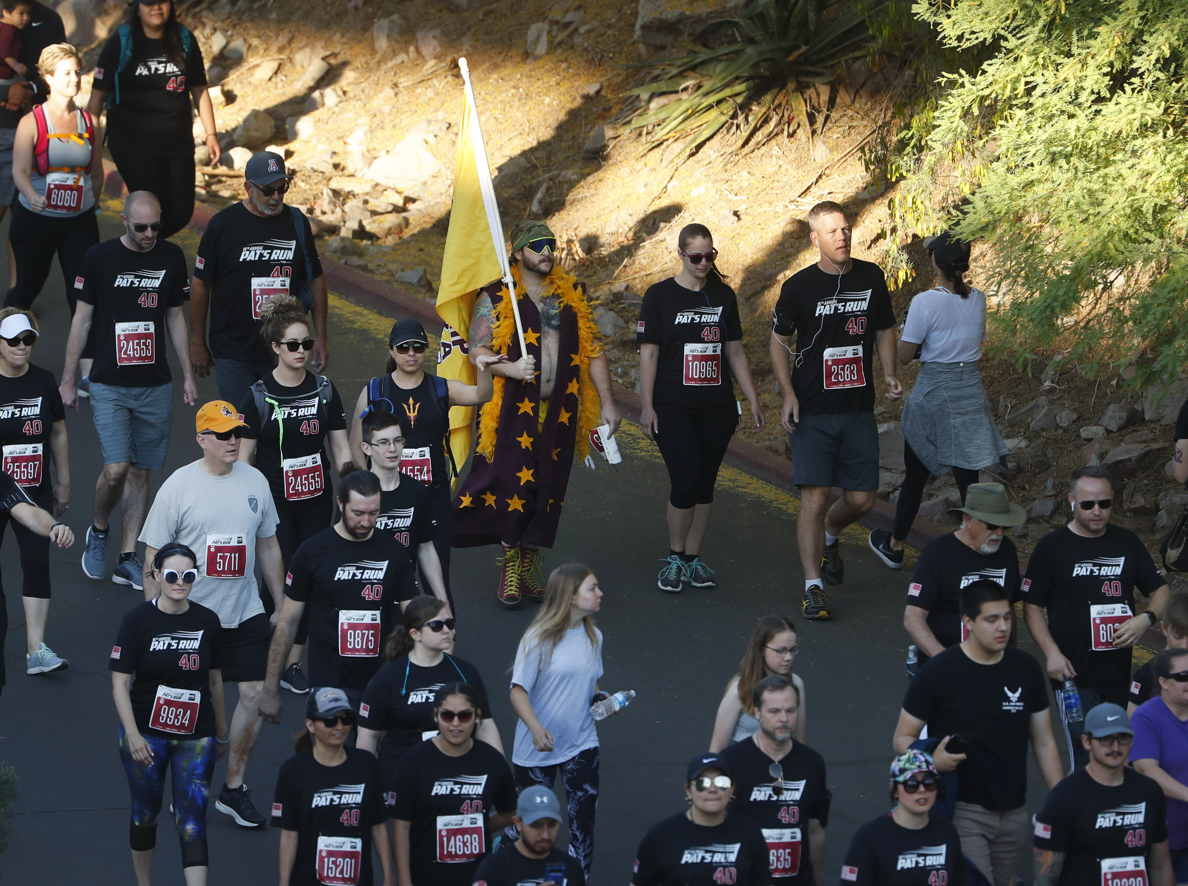 Participants make their way to the starting line during Pat's Run 2019 in Tempe, Ariz. on April 27, 2019.