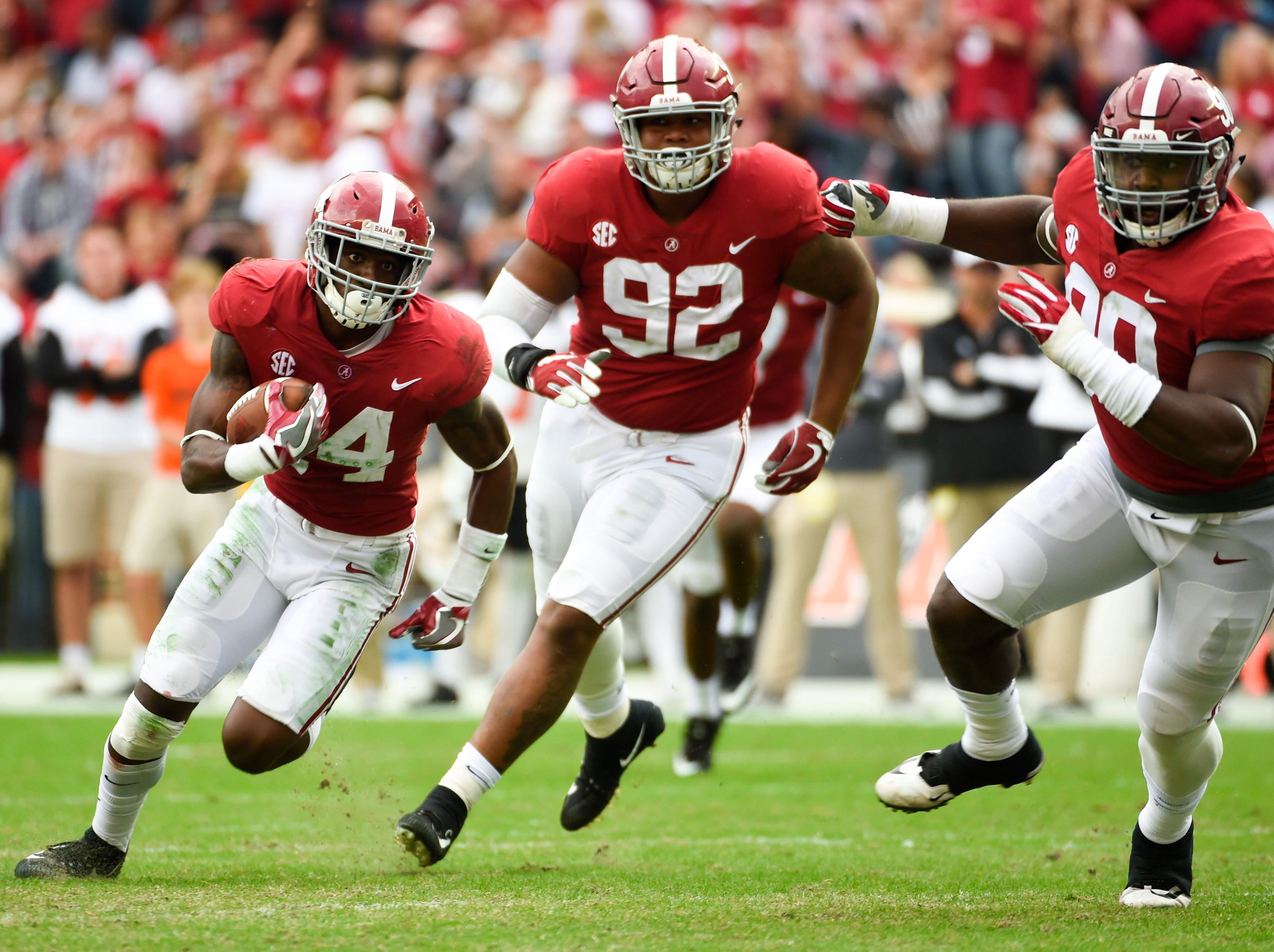Alabama safety Deionte Thompson (14) returns an interception during a game against Mercer at Bryant-Denny Stadium.