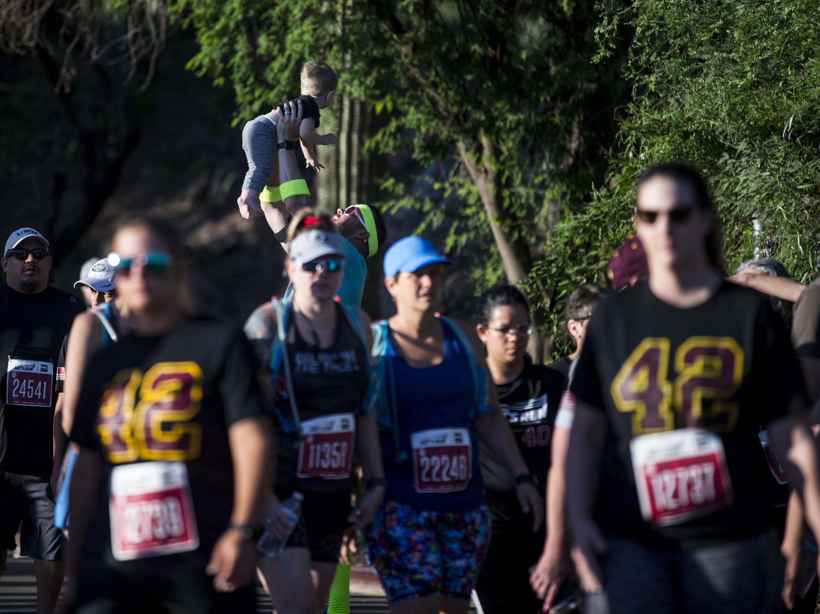 Participants arrive for the 15th Annual Pat's Run on Saturday, April 27, 2019, in Tempe, Ariz.