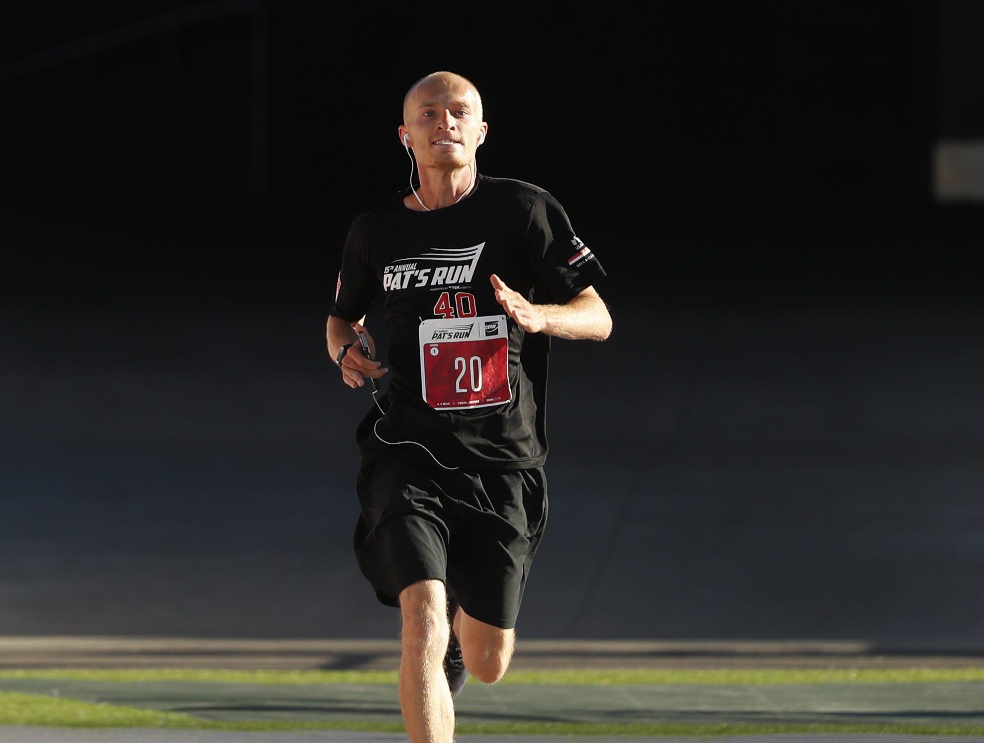 Corey Saunders makes his way down the last stretch inside Sun Devil Stadium during Pat's Run 2019 in Tempe, Ariz. on April 27, 2019.