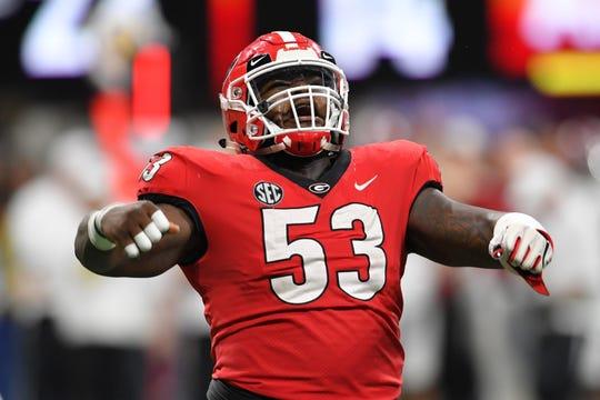 Dec 1, 2018: Georgia Bulldogs center Lamont Gaillard (53) celebrates after a touchdown against the Alabama Crimson Tide during the third quarter in the SEC championship game at Mercedes-Benz Stadium.