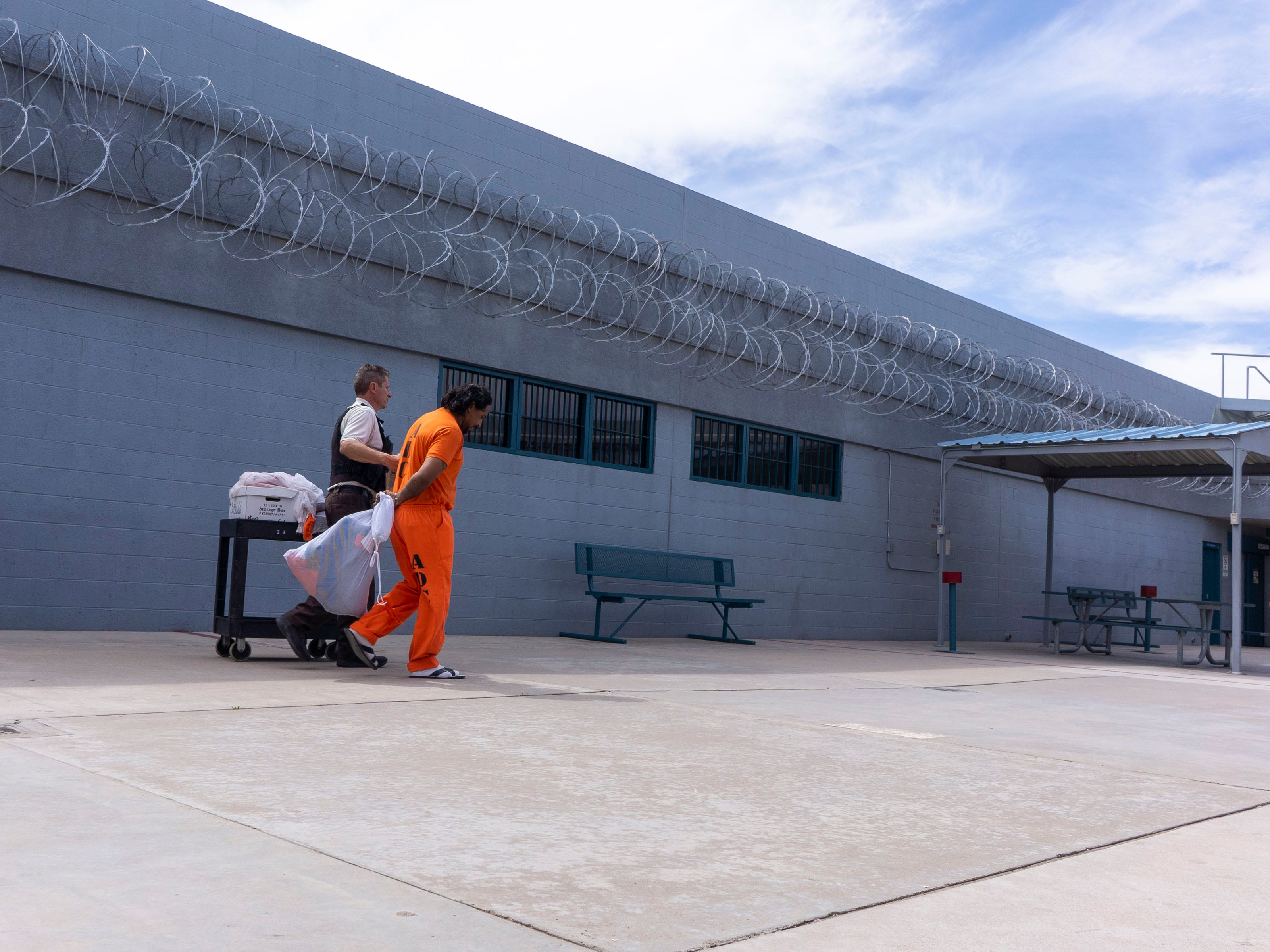 A correctional officer escorts maximum Security Prison unit inmate.