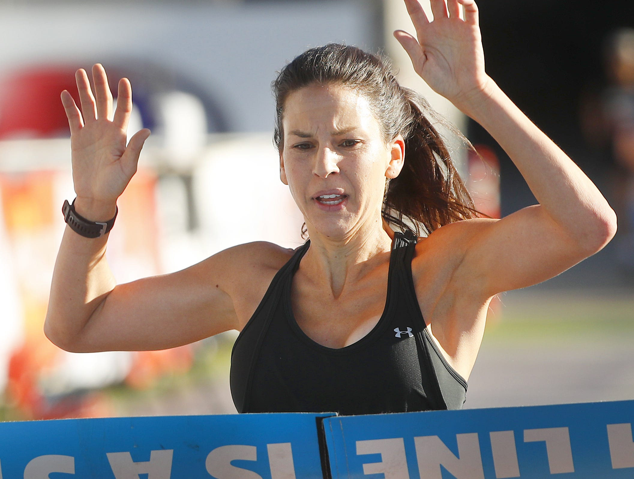 Cassandra Rios, of Phoenix, wins first place for women during Pat's Run 2019 in Tempe, Ariz. on April 27, 2019.