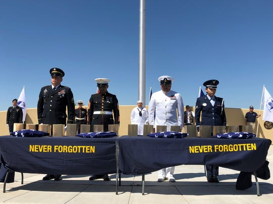 A moment of silence is observed at the Arizona Veterans Memorial Cemetery in Marana, AZ on Saturday morning, April 27, 2019, as 17 unclaimed veterans were laid to rest as part of the Missing in Arizona Project.
