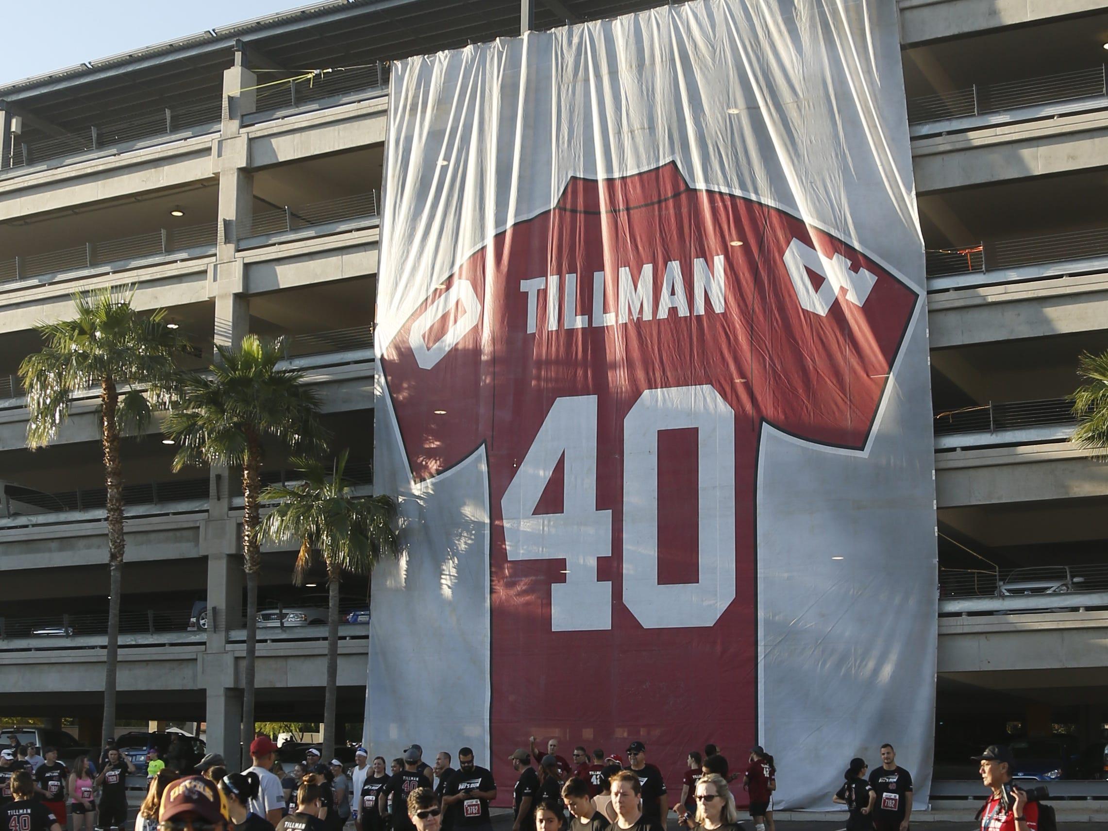 A Pat Tillman jersey banner hangs off the parking garage during Pat's Run 2019 in Tempe, Ariz. on April 27, 2019.
