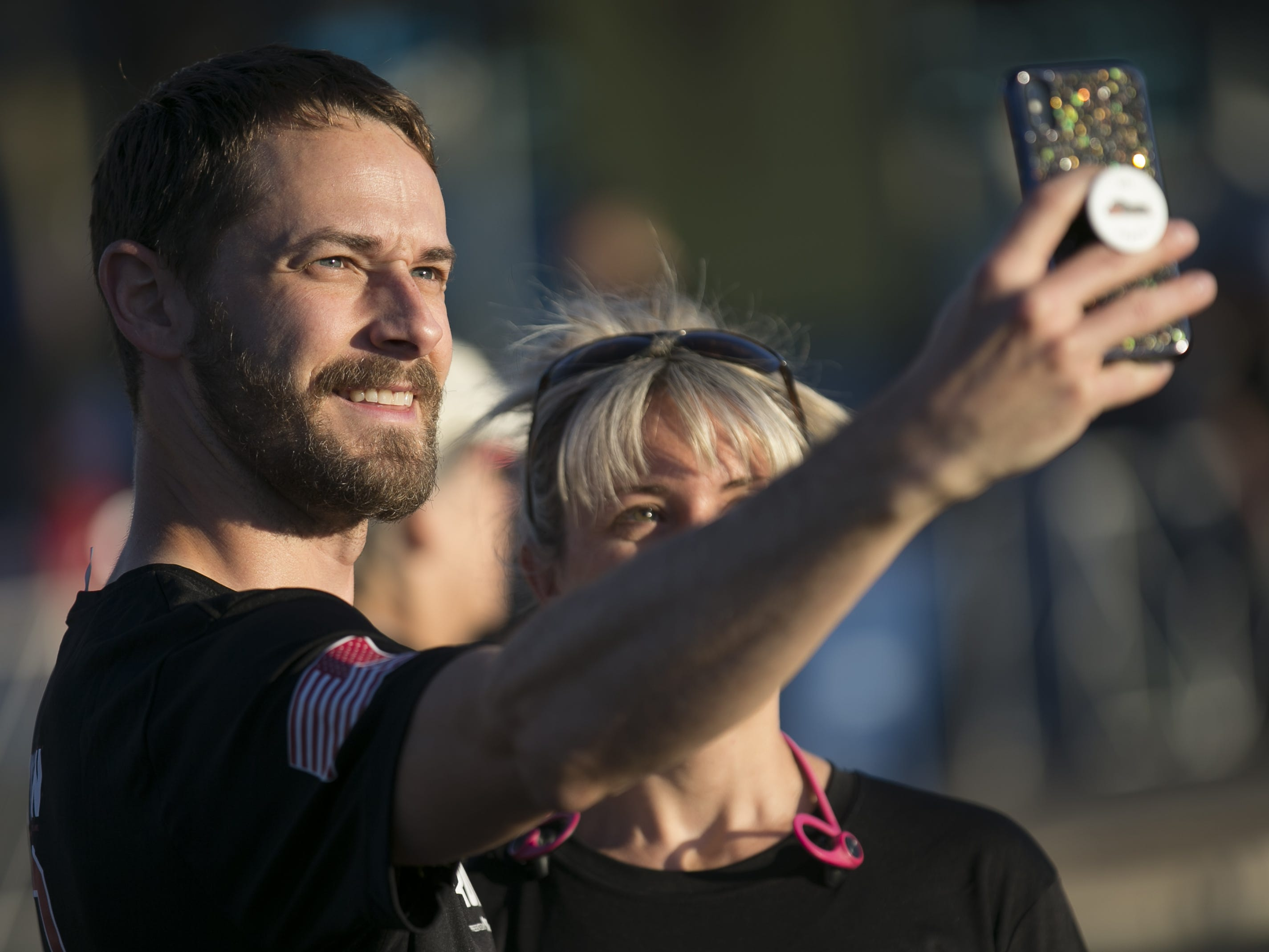 Joel Erickson (left) and Katie Erickson (right) take a selfie at Pat's Run 2019 in Tempe on April 27, 2019.