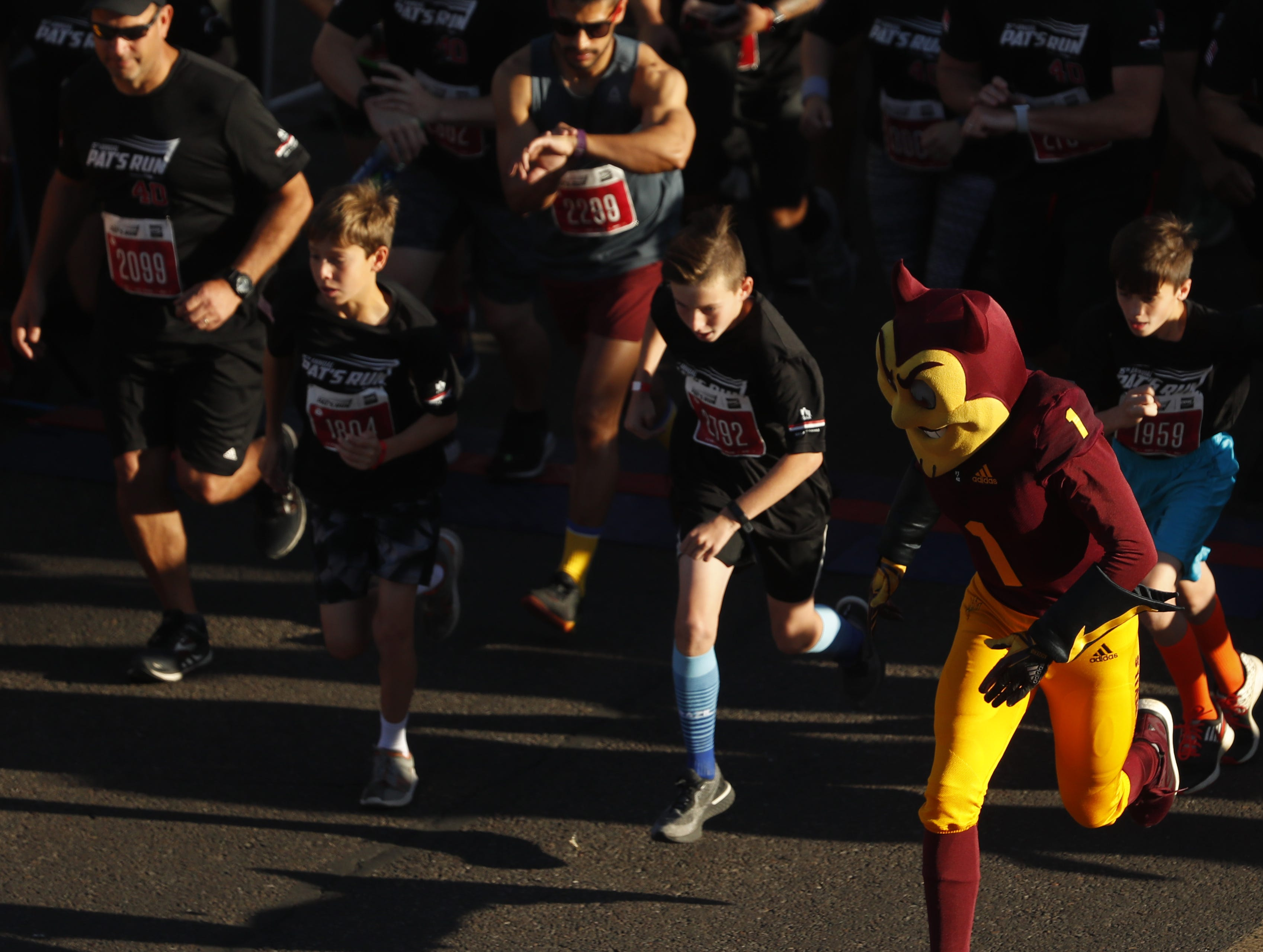 Sparky helps lead off the third corral during Pat's Run 2019 in Tempe, Ariz. on April 27, 2019.