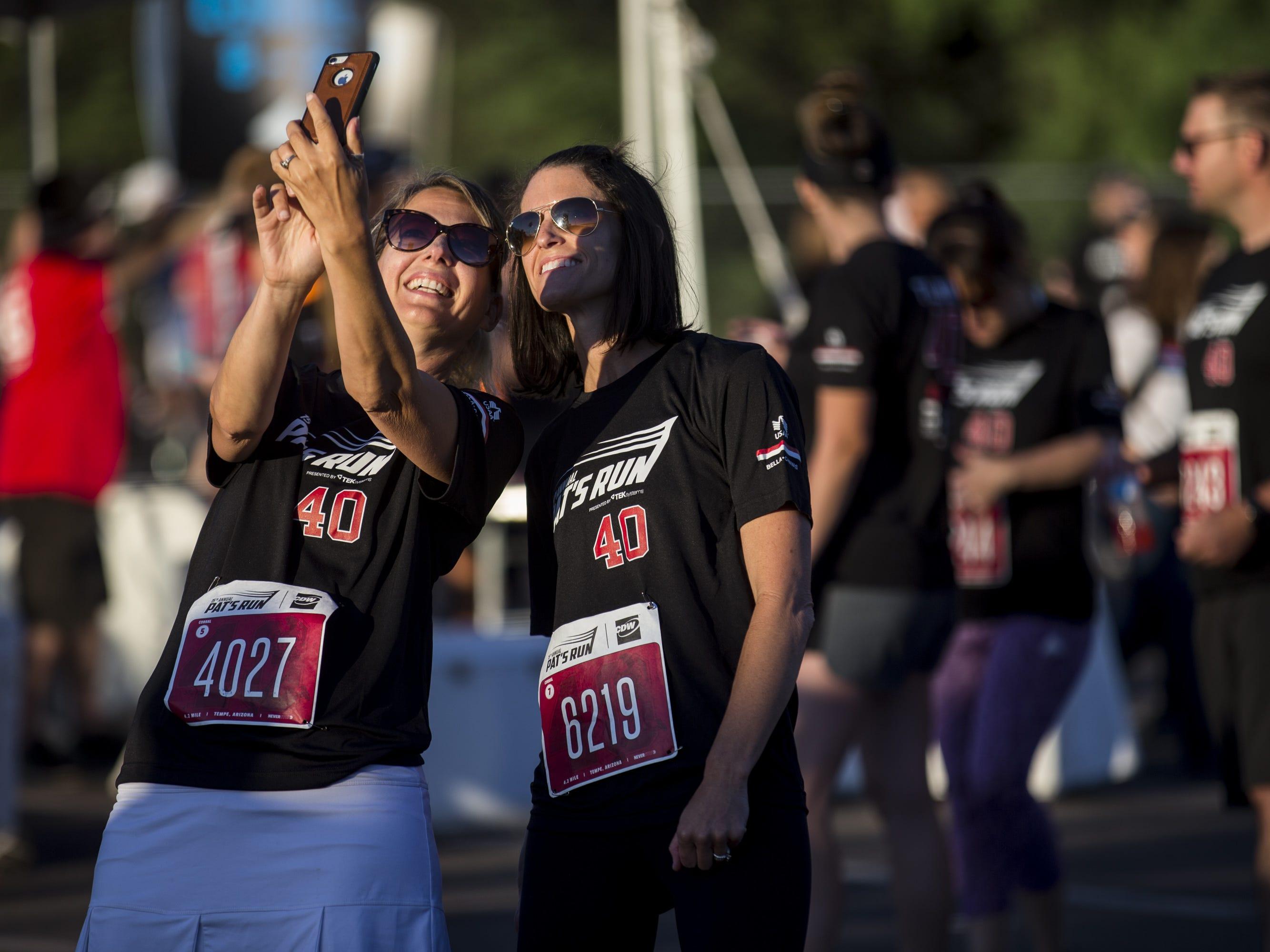 Participants take photos before the 15th Annual Pat's Run on Saturday, April 27, 2019, in Tempe, Ariz.