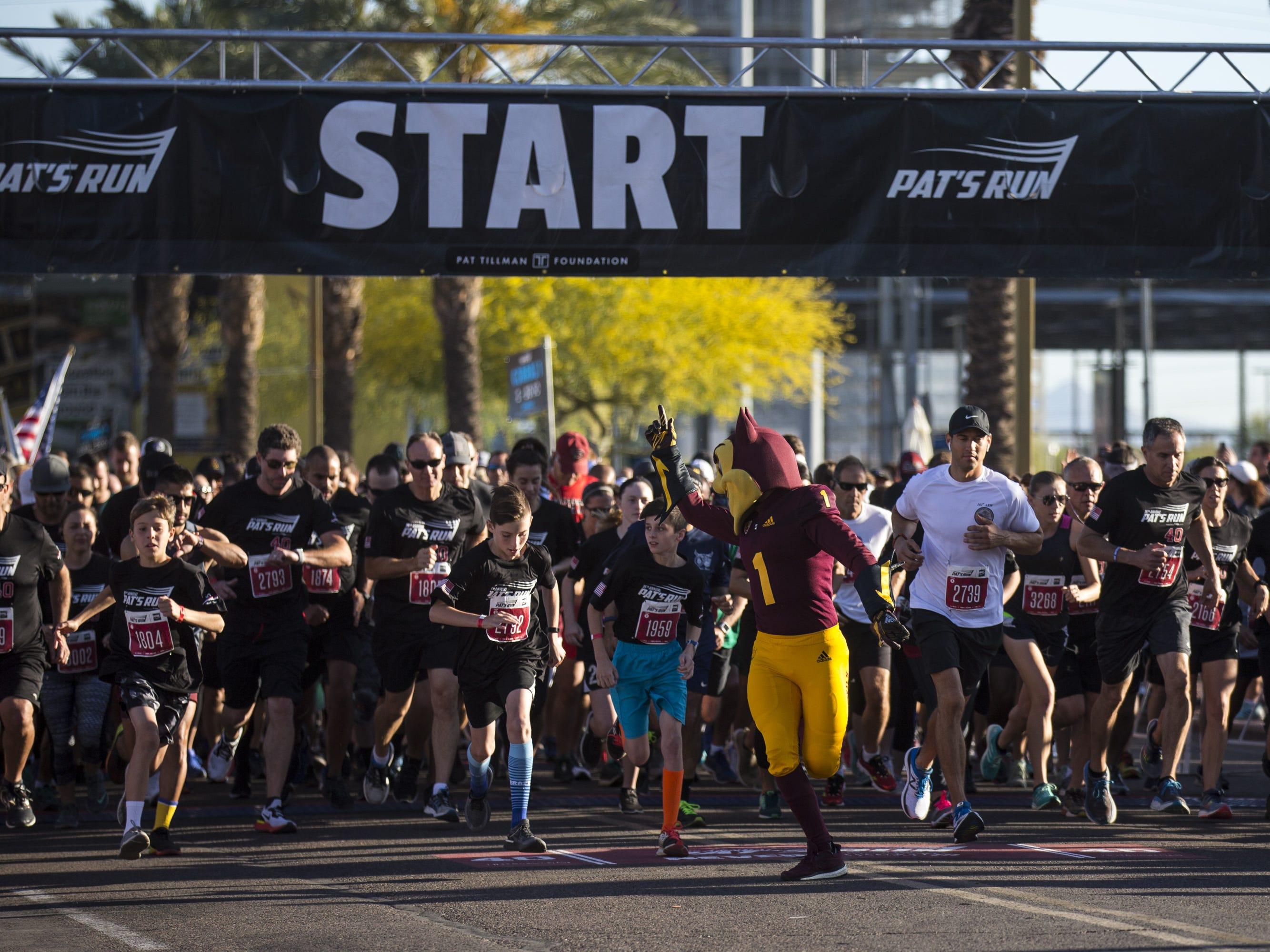 Participants run at the start line during the 15th Annual Pat's Run on Saturday, April 27, 2019, in Tempe, Ariz.