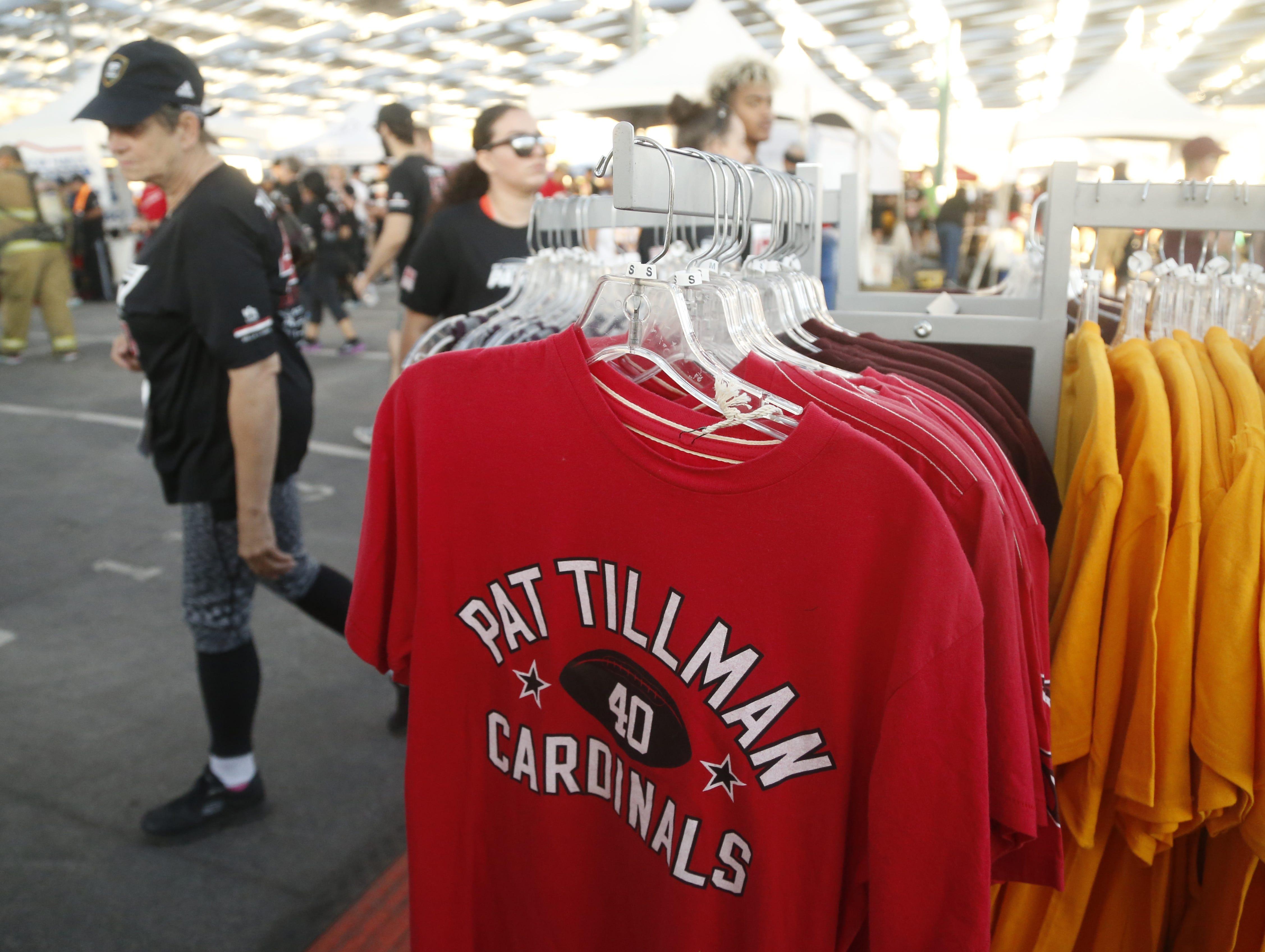 Runners buy Pat Tillman gear during Pat's Run 2019 in Tempe, Ariz. on April 27, 2019.