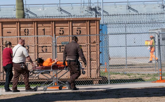 An inmate is removed to get medical attention, according to Prison Operations Director Carson A. McWilliams. Arizona Department of Corrections is struggling with understaffing due to a decade-long pay freeze.