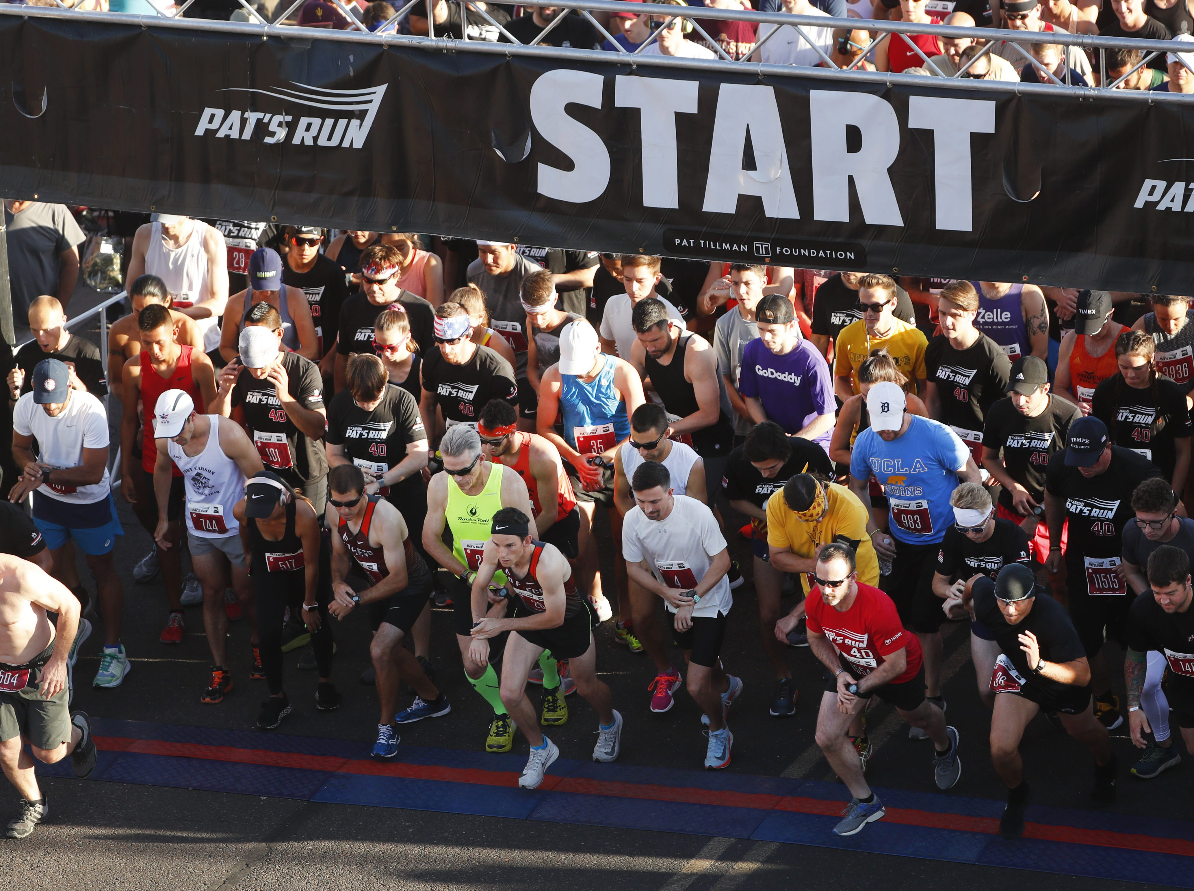 Runners take off from the starting line during Pat's Run 2019 in Tempe, Ariz. on April 27, 2019.