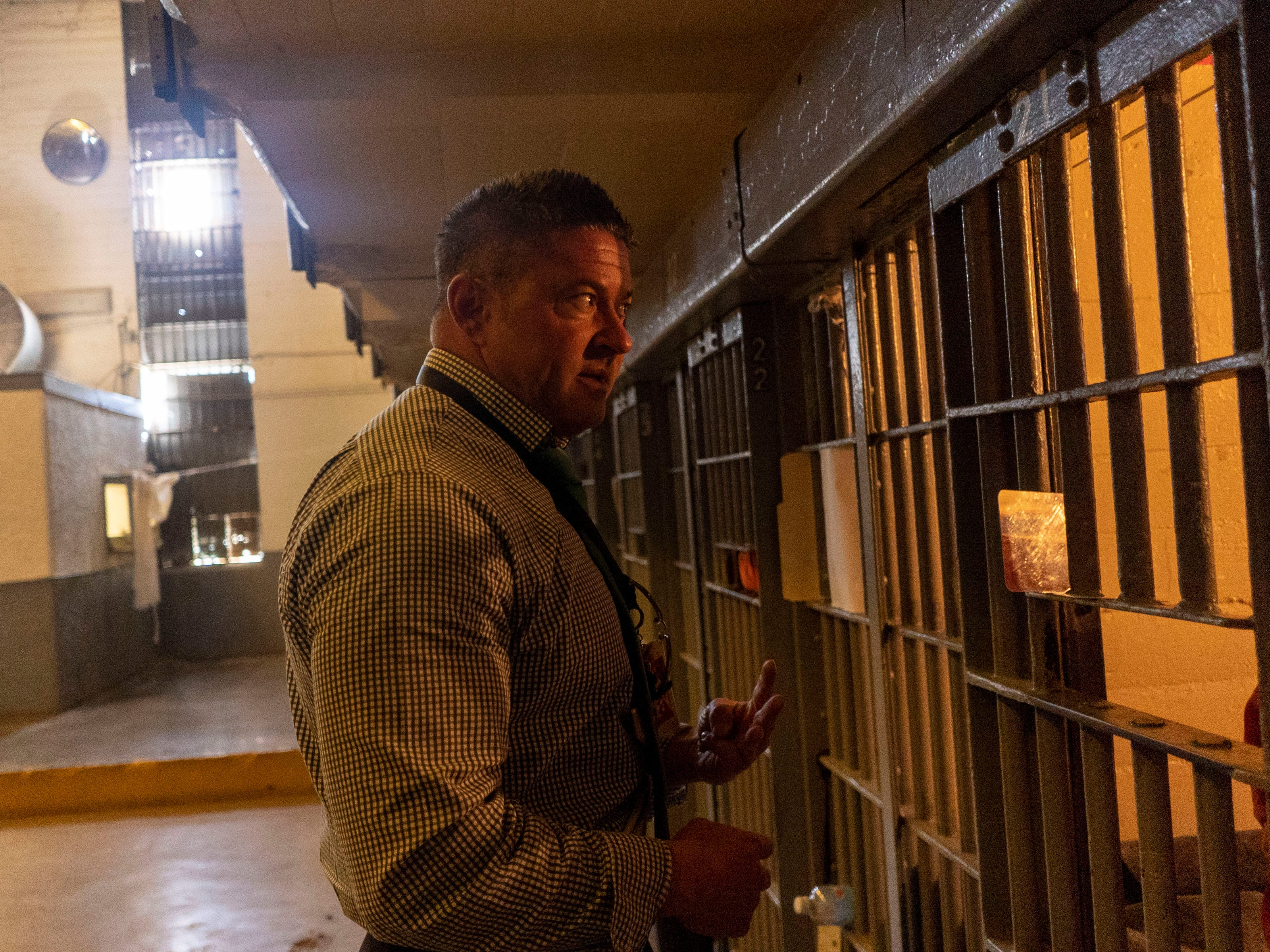 Deputy Warden Jason Monson talks to one of the inmate in his cell while he oversees the Central Unit at the Florence Arizona State Prison Complex.