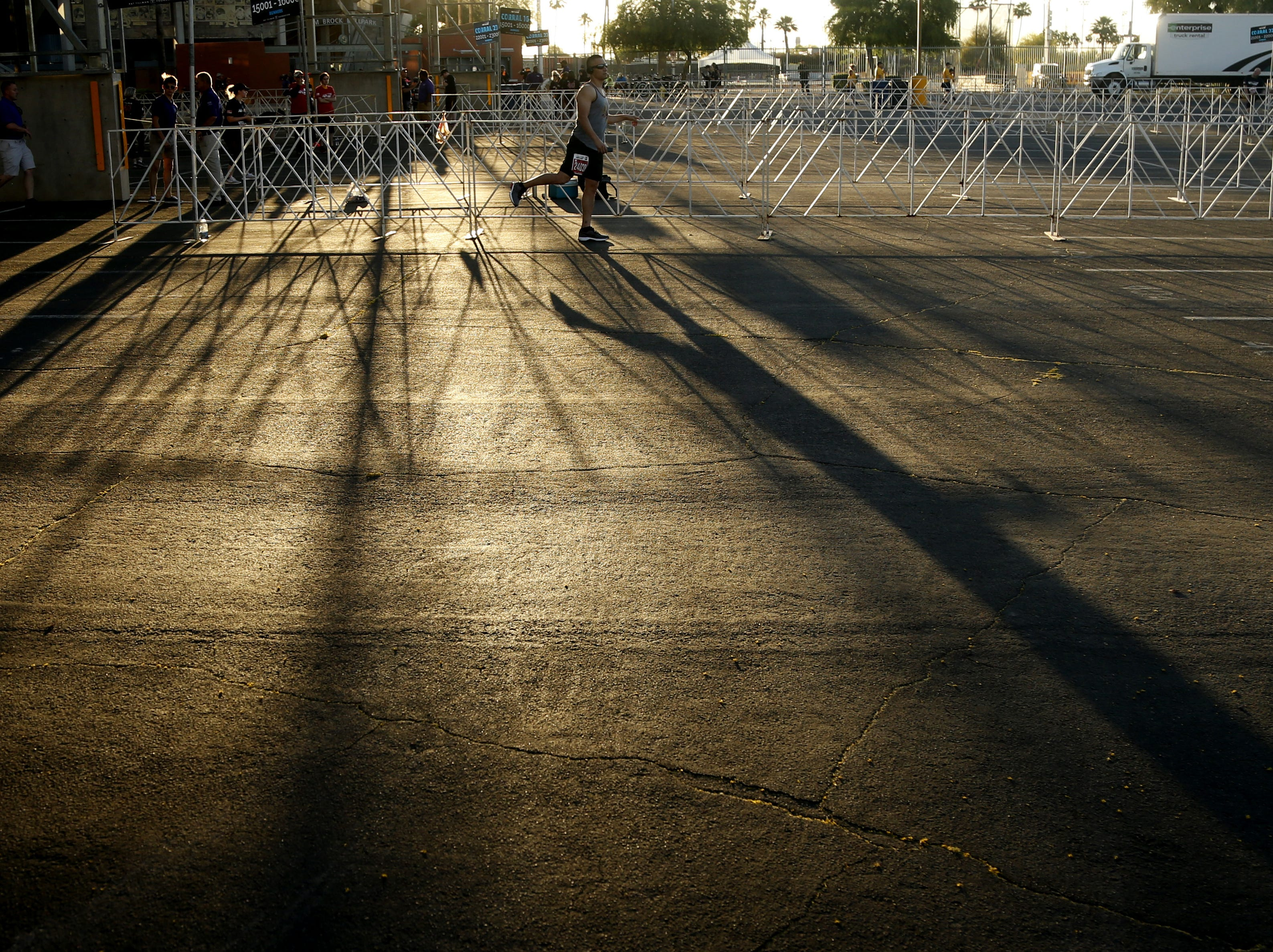 Runners warm up in their corrals as the sun rises before Pat's Run 2019 in Tempe, Ariz. on April 27, 2019.