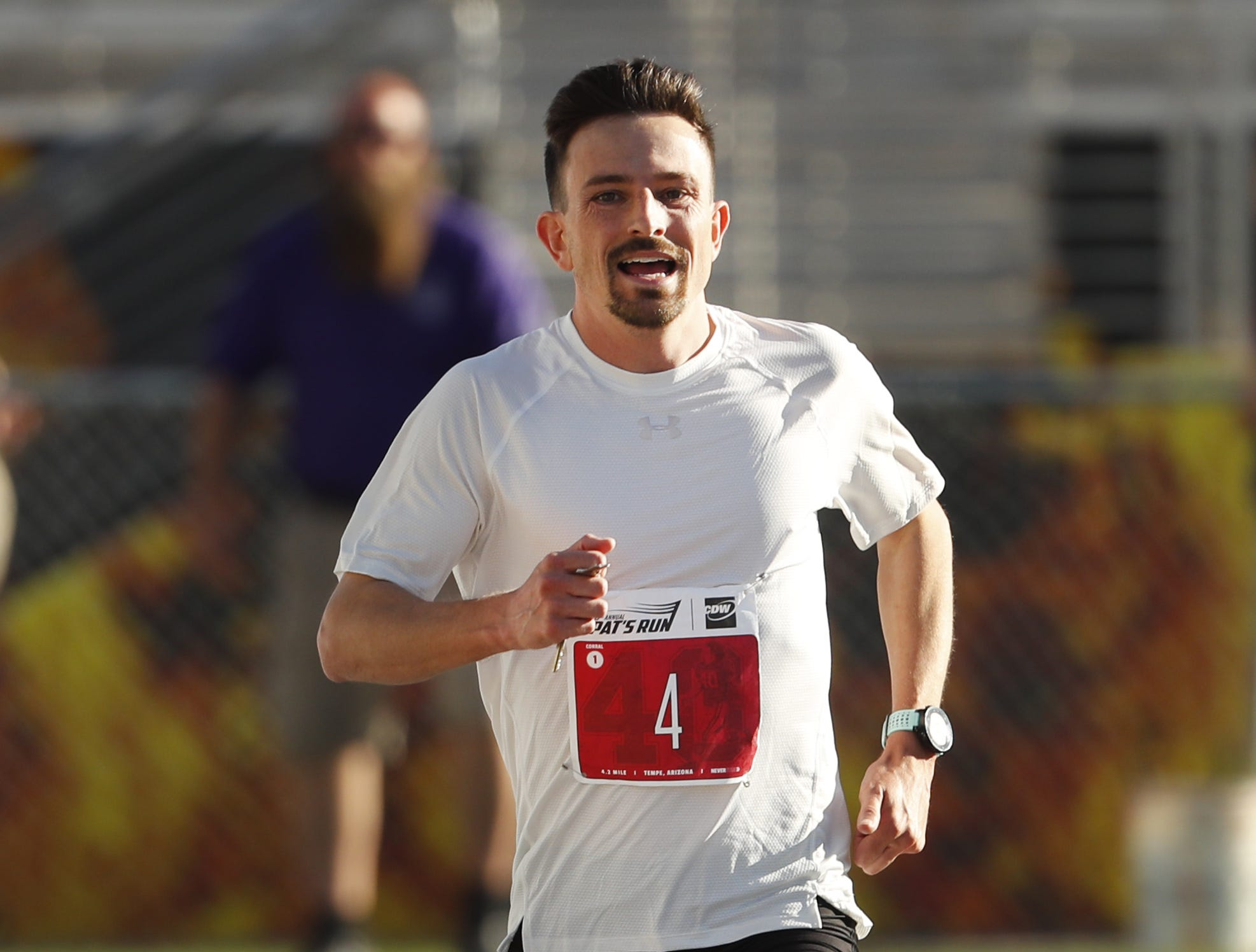 George Alex, of Phoenix, wins first place for men during Pat's Run 2019 in Tempe, Ariz. on April 27, 2019.