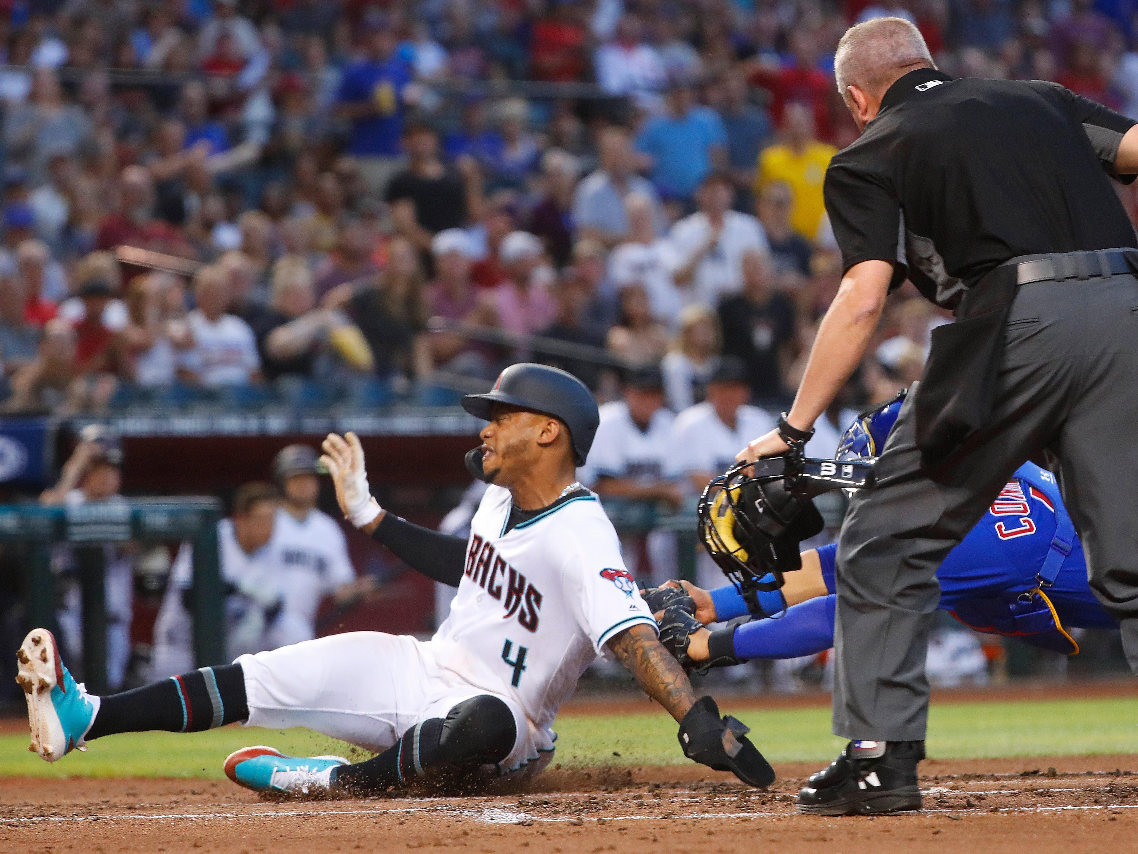 Diamondbacks' Ketel Marte (4) slides safely in past the tag of Cubs' Willson Contreras (40) during the first inning at Chase Field in Phoenix, Ariz. on April 26, 2019.