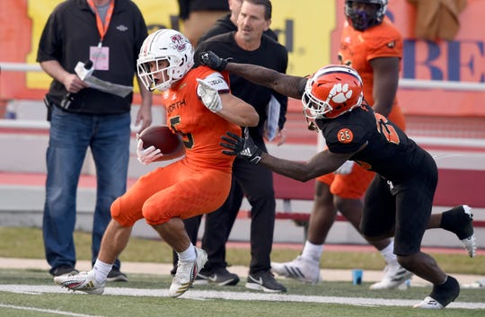 Jan 26, 2019; Mobile, AL, United States; North wide receiver Andy Isabella of UMASS (5) carries down the field on a reception against South defensive back Mark Fields of Clemson (26) during the second half at Ladd-Peebles Stadium. Mandatory Credit: John David Mercer-USA TODAY Sports