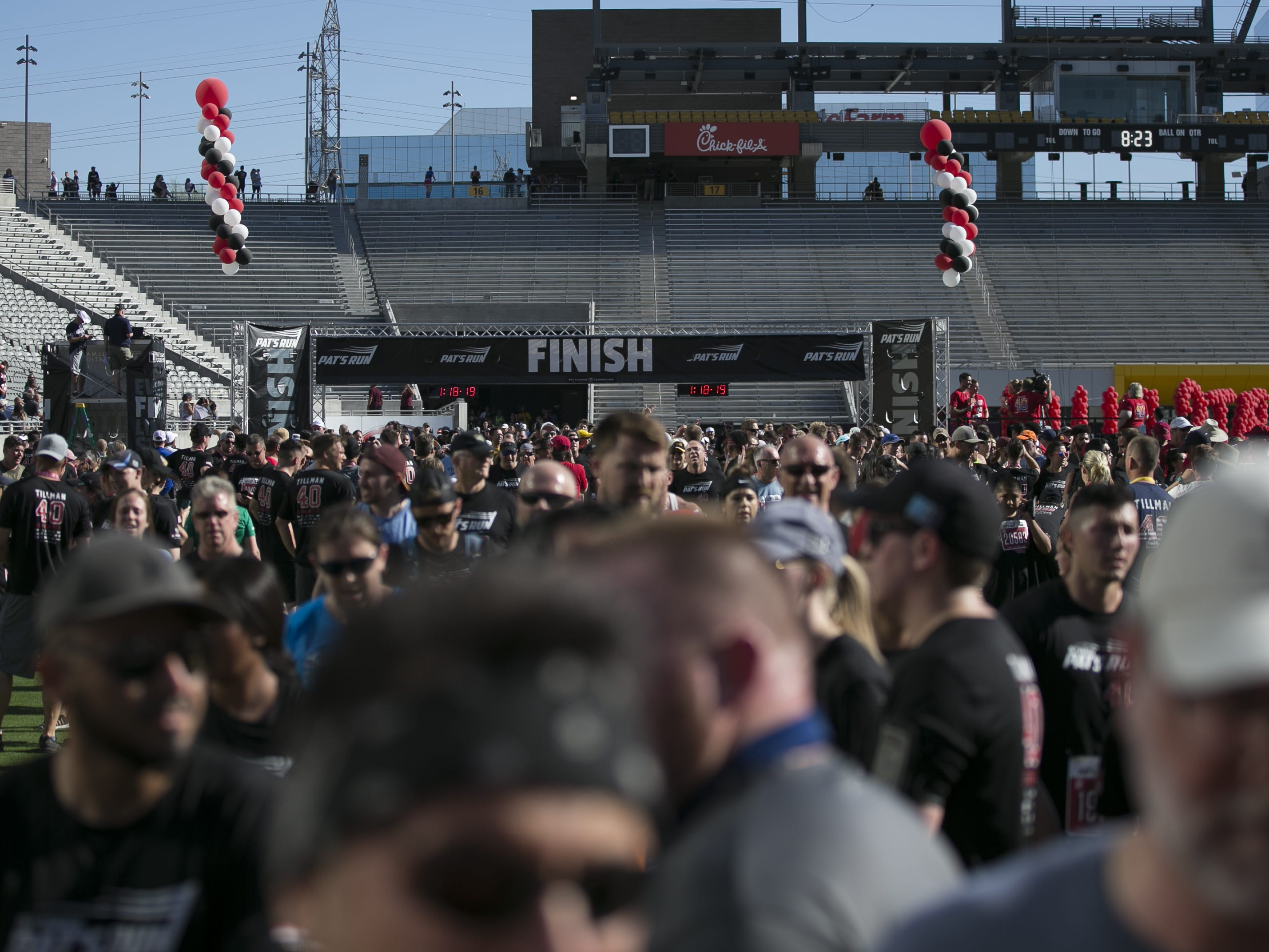 Runners cross the finish line at Pat's Run 2019 in Tempe on April 27, 2019.