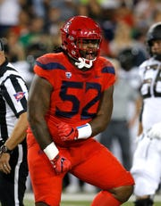 Arizona defensive tackle PJ Johnson (52) reacts after making a tackle for a loss against Oregon in the first half during an NCAA college football game, Saturday, Oct. 27, 2018, in Tucson, Ariz.