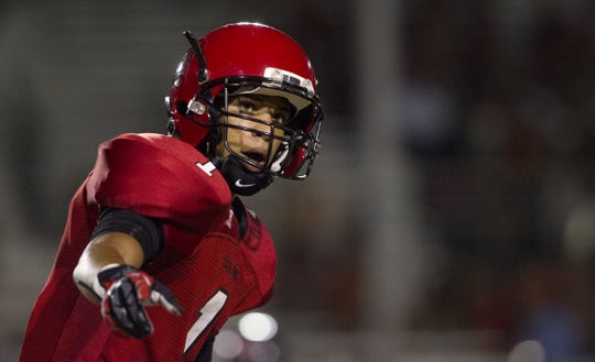 Paradise Valley's Jordan Brown lines up at the line of scrimmage against Liberty at Paradise Valley High School in Phoenix, AZ, on Sept. 4, 2012.