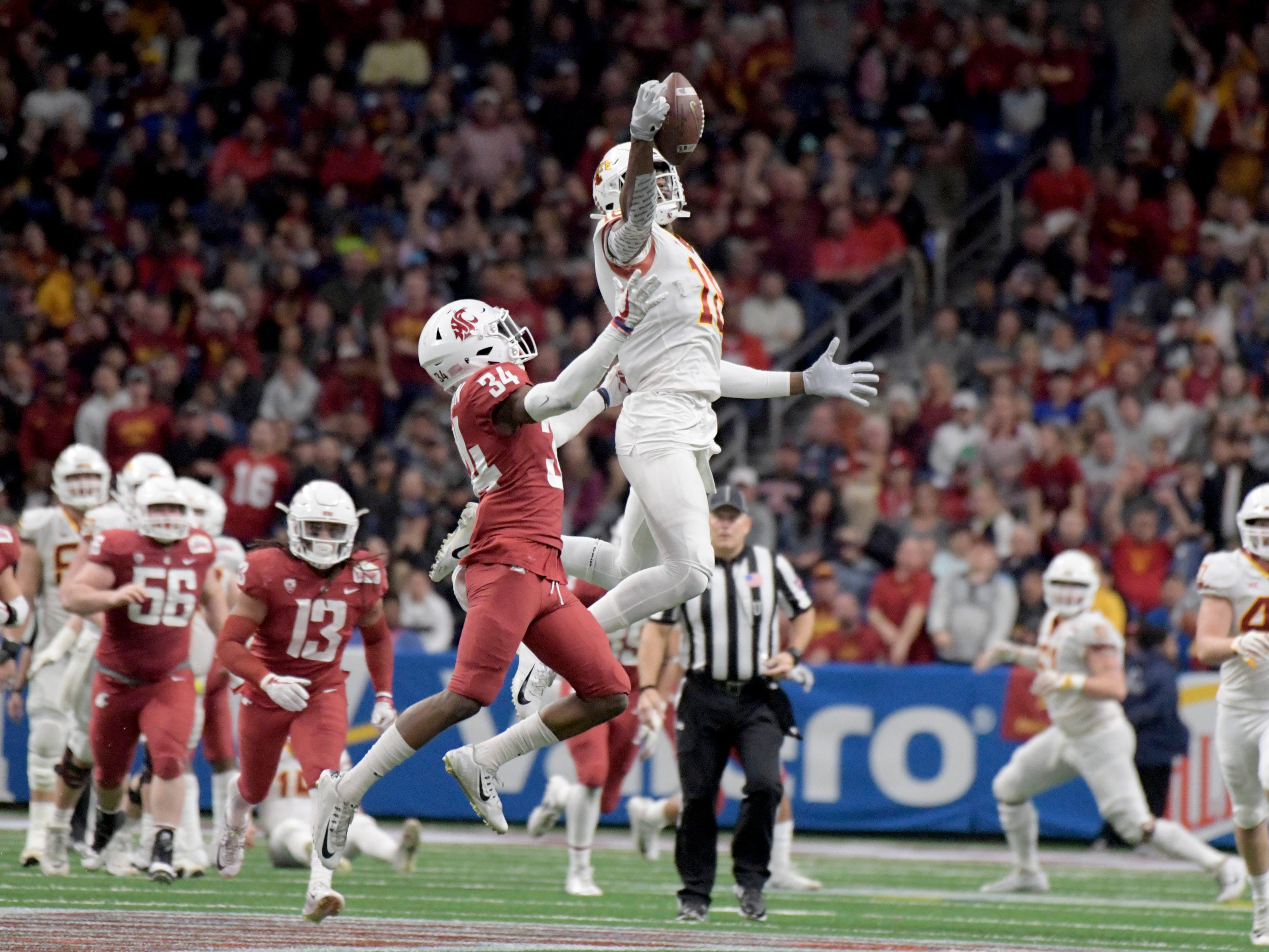 Iowa State receiver Hakeem Butler (18) makes a catch in front of Washington State safety Jalen Thompson (34) during  the Alamo Bowl at Alamodome.