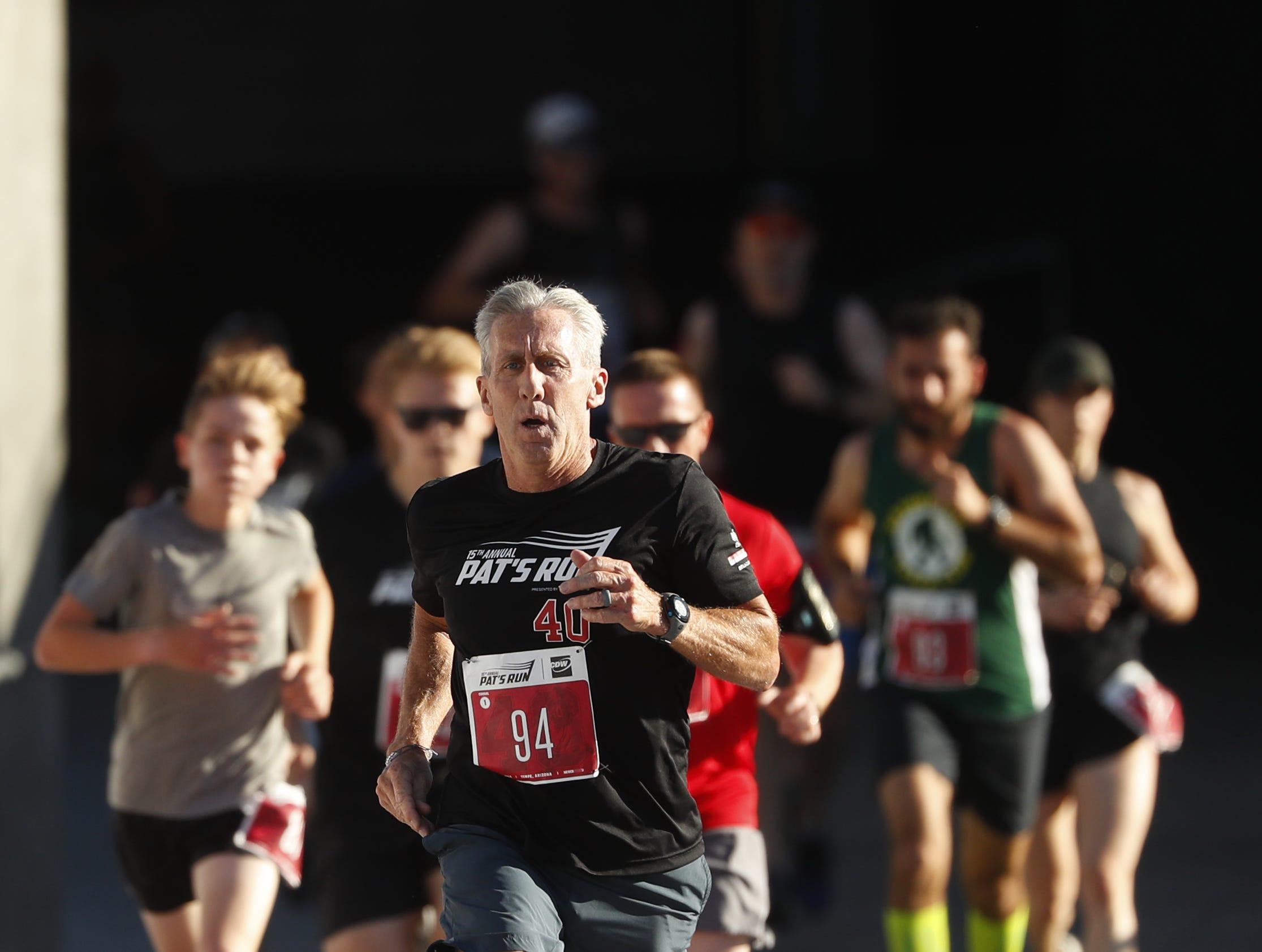 Runners finish up the last stretch of Pat's Run 2019 inside Sun Devil Stadium in Tempe, Ariz. on April 27, 2019.