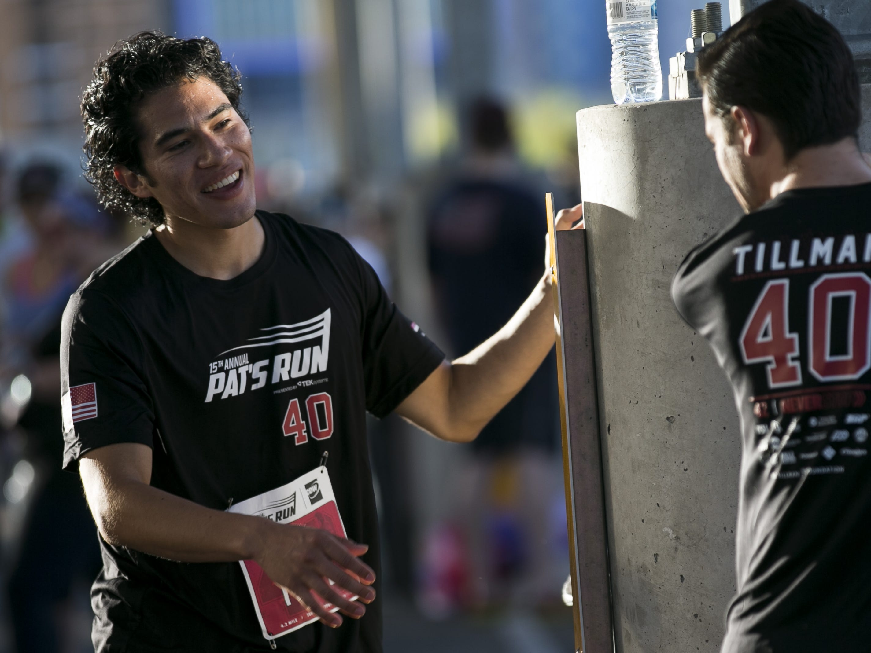 Diego Yanez (left) stretches before participating in Pat's Run 2019 in Tempe on April 27, 2019.
