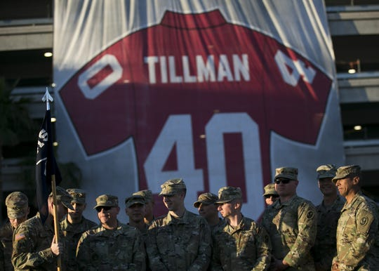 Service men with the 1st of the 415 stand in front of the Pat Tillman jersey banner at Pat's Run 2019 in Tempe on April 27, 2019.