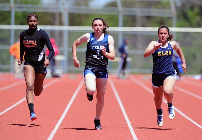 Cedar Crest's Shayla Bonzelet outraces Palmyra's Maliyah Stough, left, and Elco's Katelyn Rueppel to the 100 meter dash title.