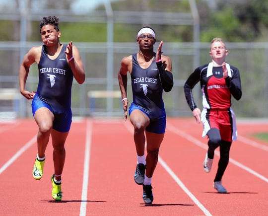 Cedar Crest's Jepel Gibbs, middle, speeds to the 100 meter dash title at Saturday's Lebanon County meet as teammate Chris Rios, left, and Annville-Cleona's MIchael Moran give chase.