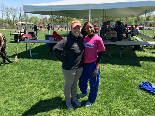 Shannon Kalnoski Bixler, left, and Cedar Crest's DeAsia Holloman pose together moments after Holloman broke Kalnoski Bixler's 27-year old Lebanon County meet record in the 100 meter high hurdles on Saturday.