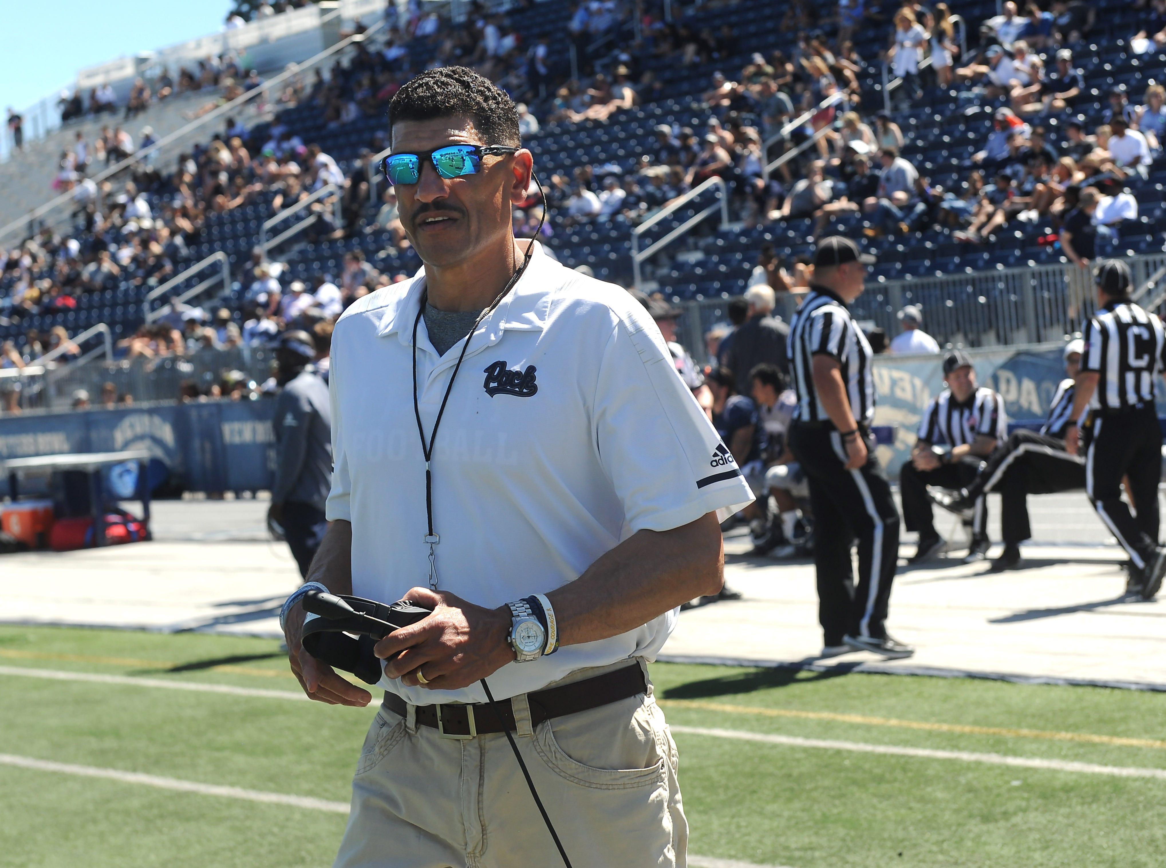 Head coach Jay Norvell runs the Nevada Football annual spring game at Mackay Stadium in Reno on April 27, 2019.