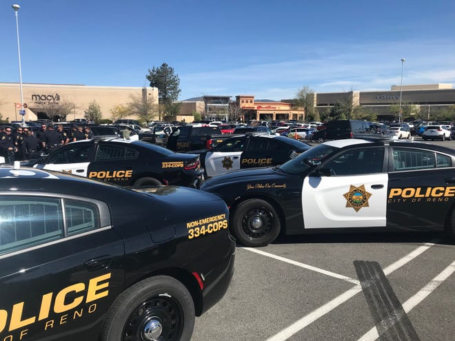Reno police gather outside Meadowood Mall, where access to part of the mall was shut down while the Consolidated Bomb Unit removed a suspicious package on Saturday, April 27. The package is still under investigation.