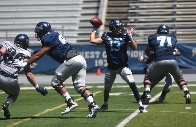Nevada quarterback Cristian Solano throws during the Wolf Pack's spring game at Mackay Stadium.