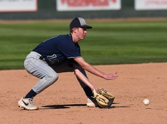 Zach Rigdon fields a ground ball Thursday at Reno.