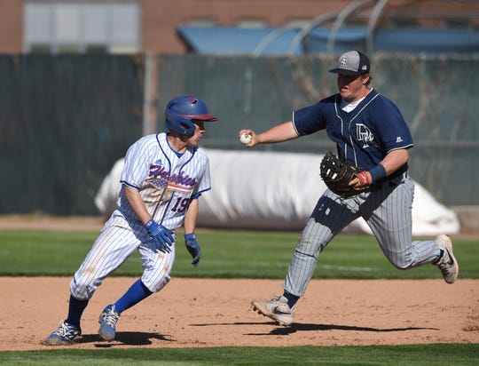 Damonte's Andrew Guidara chases Reno's Cade Grogan as he gets caught  between first and second base during Thursday's game at Reno.