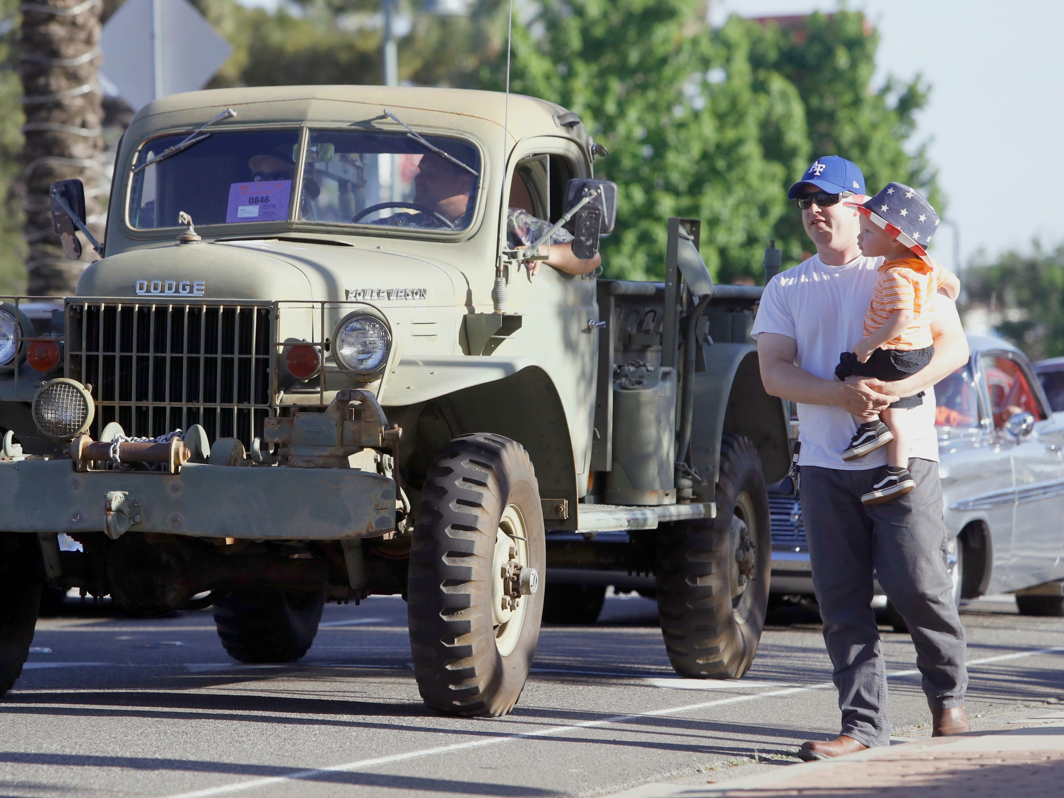 Devon Smith of Redding holds his 20-month-old son Beckett as the Friday Night Cruise gets underway during the 2019 Kool April Nites classic car show in Redding. This was Beckett's first visit to the annual cruise.