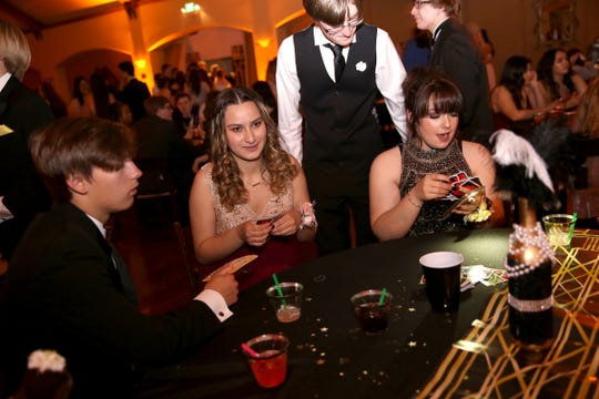 Sprague High School students play UNO during a power outage at Zenith Vineyards on April 26, 2019. The prom will be rescheduled.
