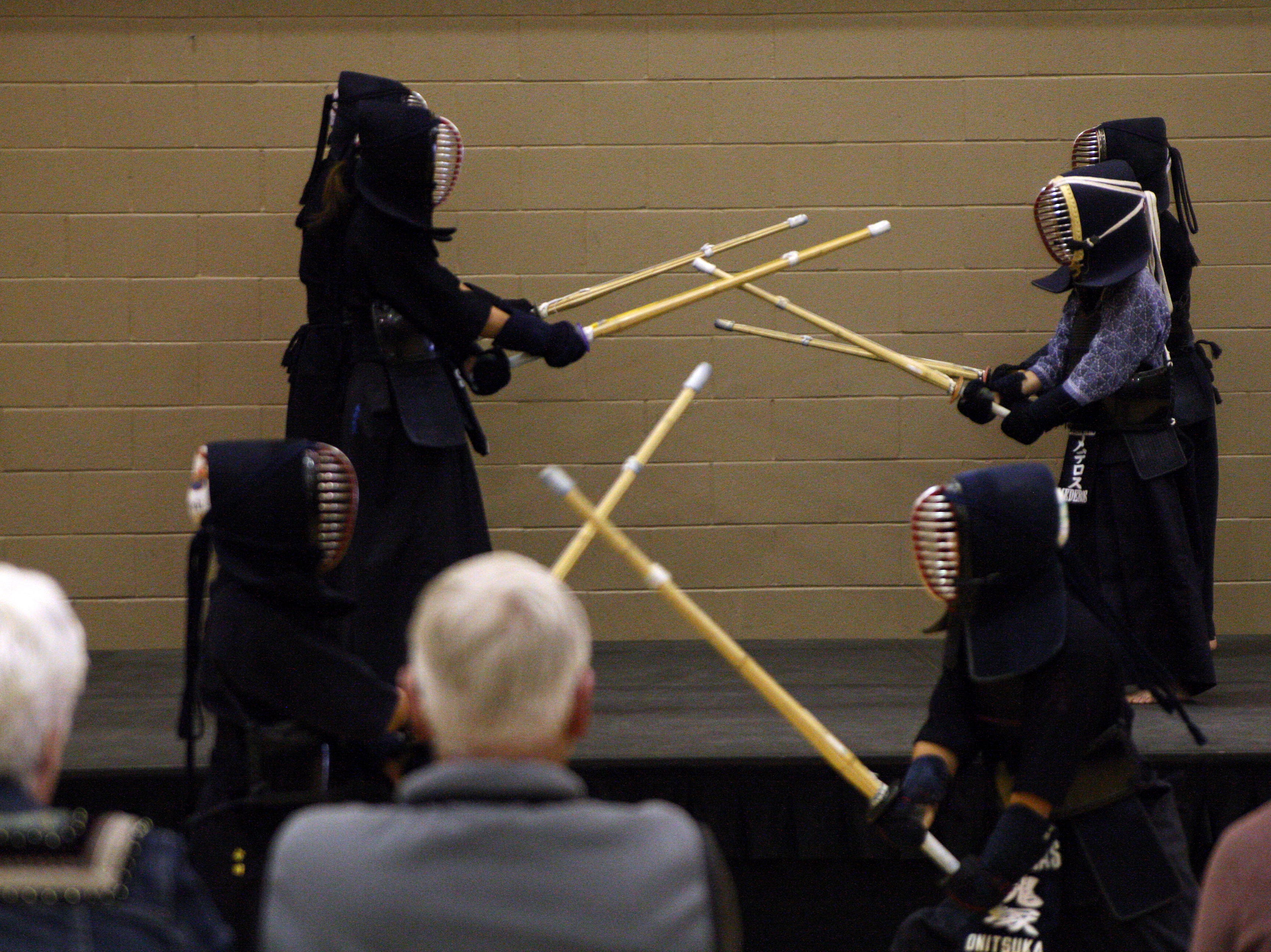 The children practice their Kendo attacks at once. April 27, 2019.