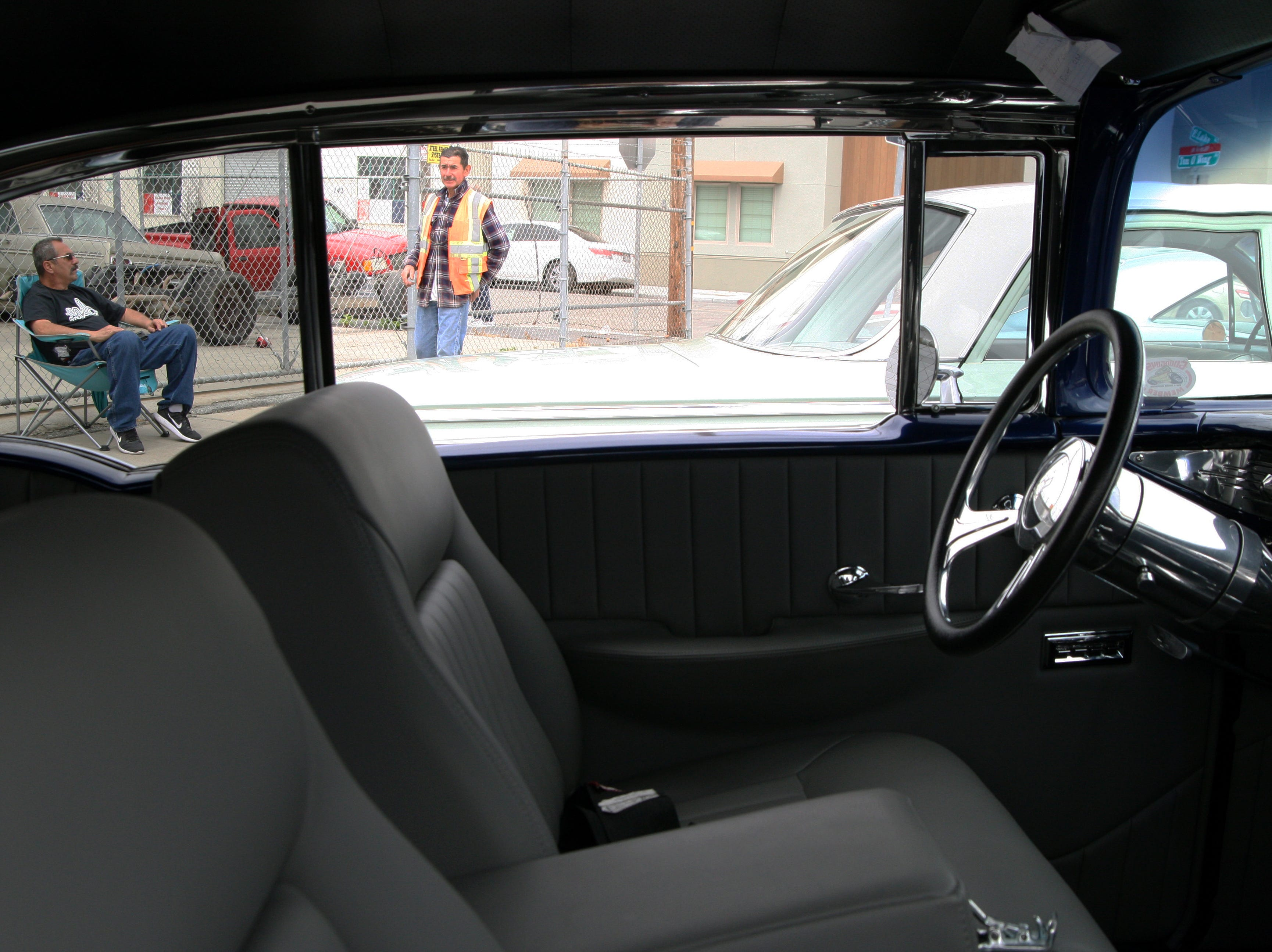 """Richard Barba talks with another classic car enthusiast. """"It's likea breath of fresh air when you drive these old cars,"""" he said. April 27, 2019."""