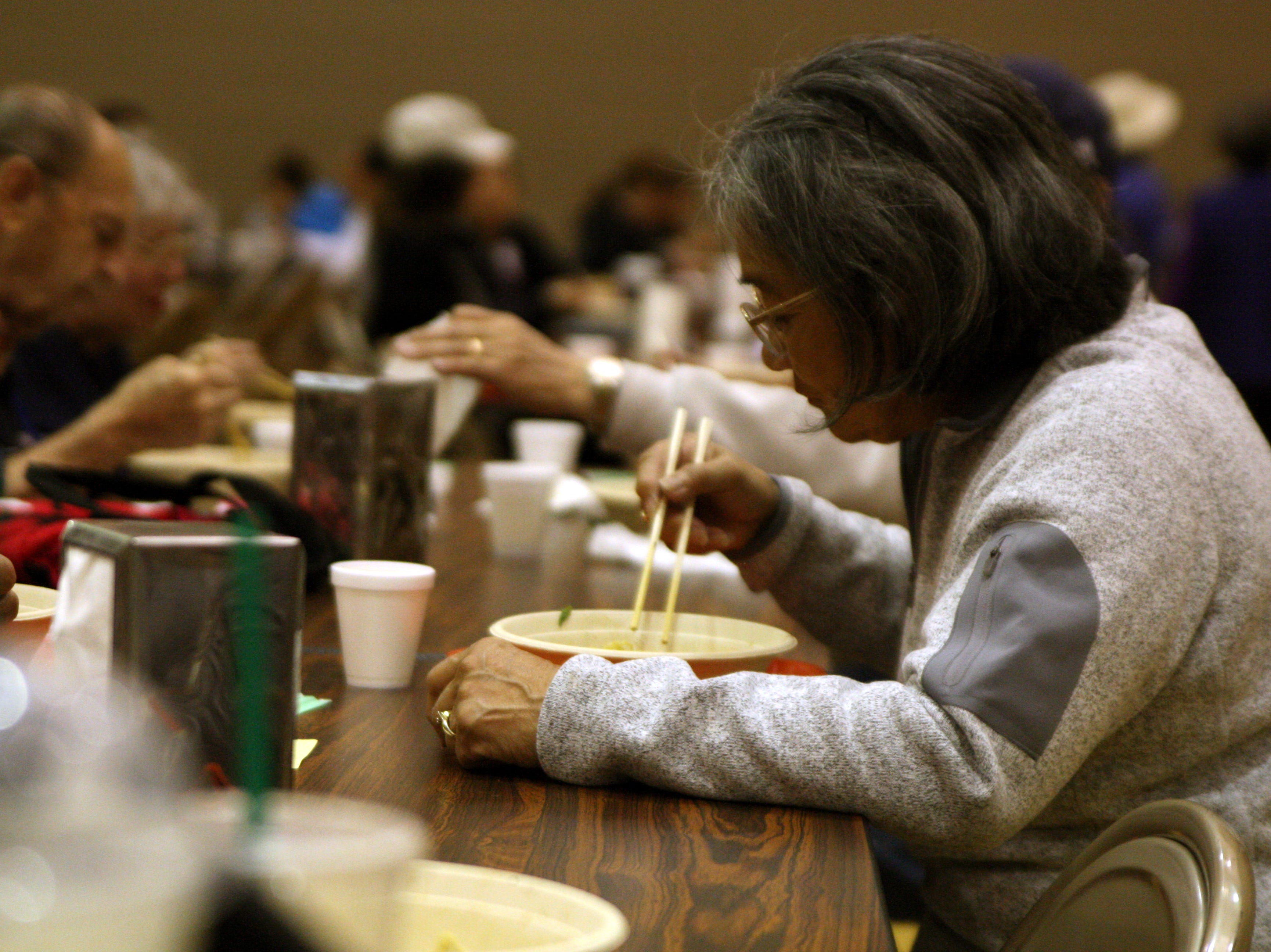 Chris Yoneyama eats ramen, seated across from her husband, Henry. She and Henry are members of the Bhuddist  Temple which hosted part of the festival. April 27, 2019.