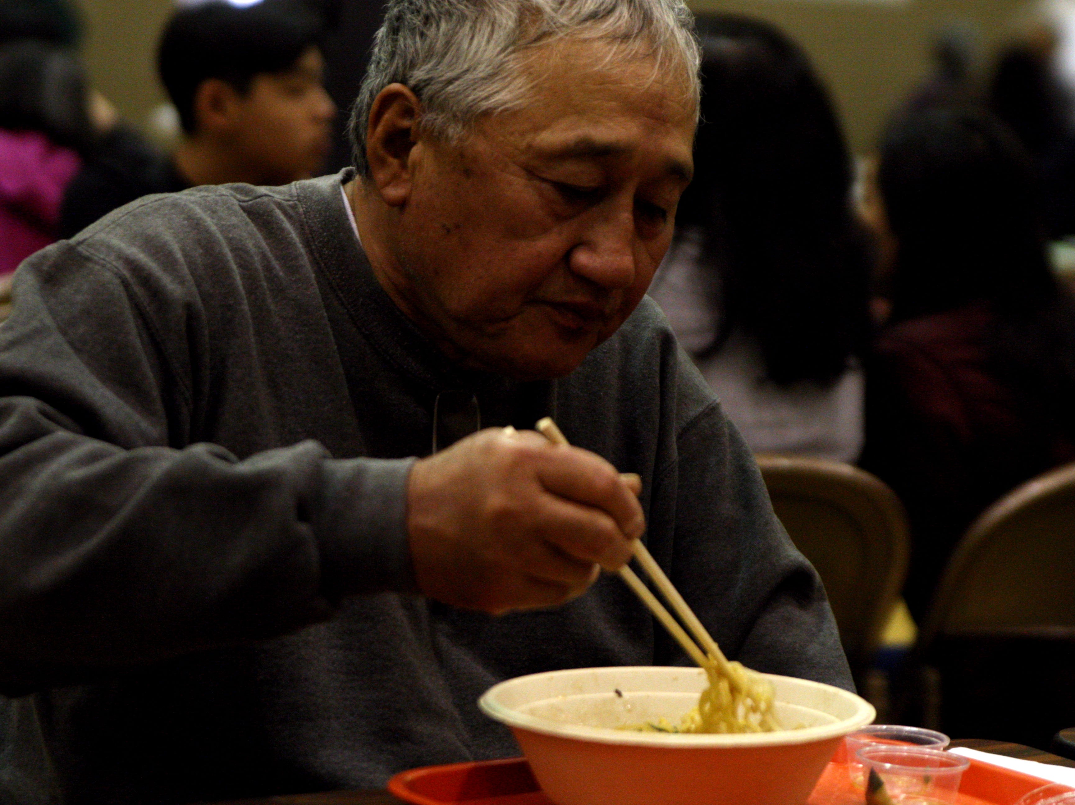 Henry Yoneyama eats ramen with his wife, Chris Yoneyama, at the 12th Annual Asian Festival. They attend most years, and say the ramen is a big attraction for them. April 27, 2019.