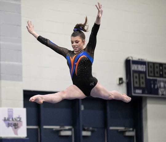 San Angelo Central's Jadyn Sawyer competes on balance beam during Day 1 of the Texas High School State Gymnastics Championships in Bryan on Friday, April 26, 2019.