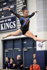 San Angelo Central's Mary Grace Thompson competes on balance beam during Day 1 of the Texas High School State Gymnastics Championships in Bryan Friday, April 26, 2019.