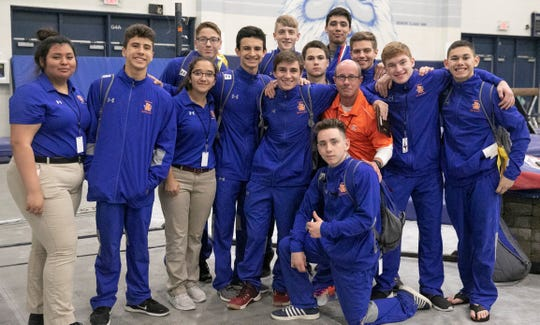 The San Angelo Central  Bobcats, team trainers and head coach Kern Arrott were all smiles at the Texas High School State Gymnastics Championships in Bryan Saturday, April 27, 2019.