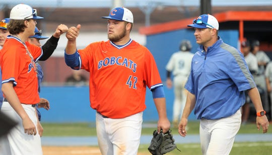San Angelo Central's Trey Neslage (left) and Gunner Couch celebrate during a game earlier in the 2019 baseball season. Head coach Patrick Penry has guided the Bobcats back to the playoffs.