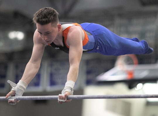 San Angelo Central's Cody Cox competes on high bar during Day 2 of the Texas High School State Gymnastics Championships in Bryan Saturday, April 27, 2019.
