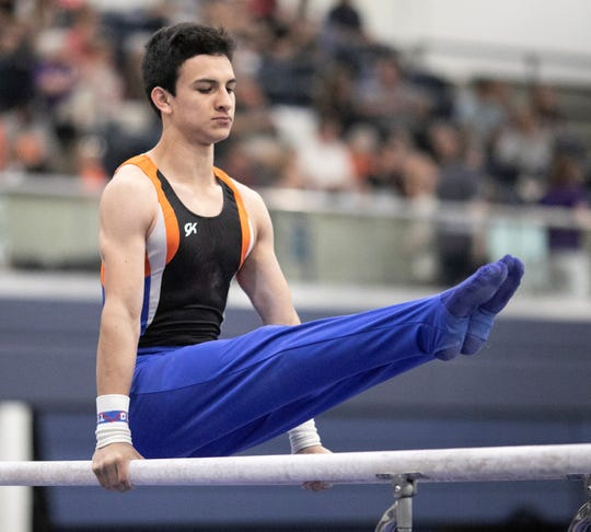 San Angelo Central's Emiliano Hinojos competes on parallel bars during Day 2 of the Texas High School State Gymnastics Championships in Bryan Saturday, April 27, 2019.